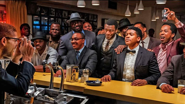 Regina King's film ONE NIGHT IN MIAMI 2020 Amazon Studios film. From right: Leslie Odom Jr, Eli Goree and Aldis Hodge with Kingsley Ben-Adir as Malcolm X taking a photo of the group