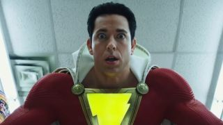 Shazam looking stunned after bullets bounce off his body during a convenience store in Shazam!
