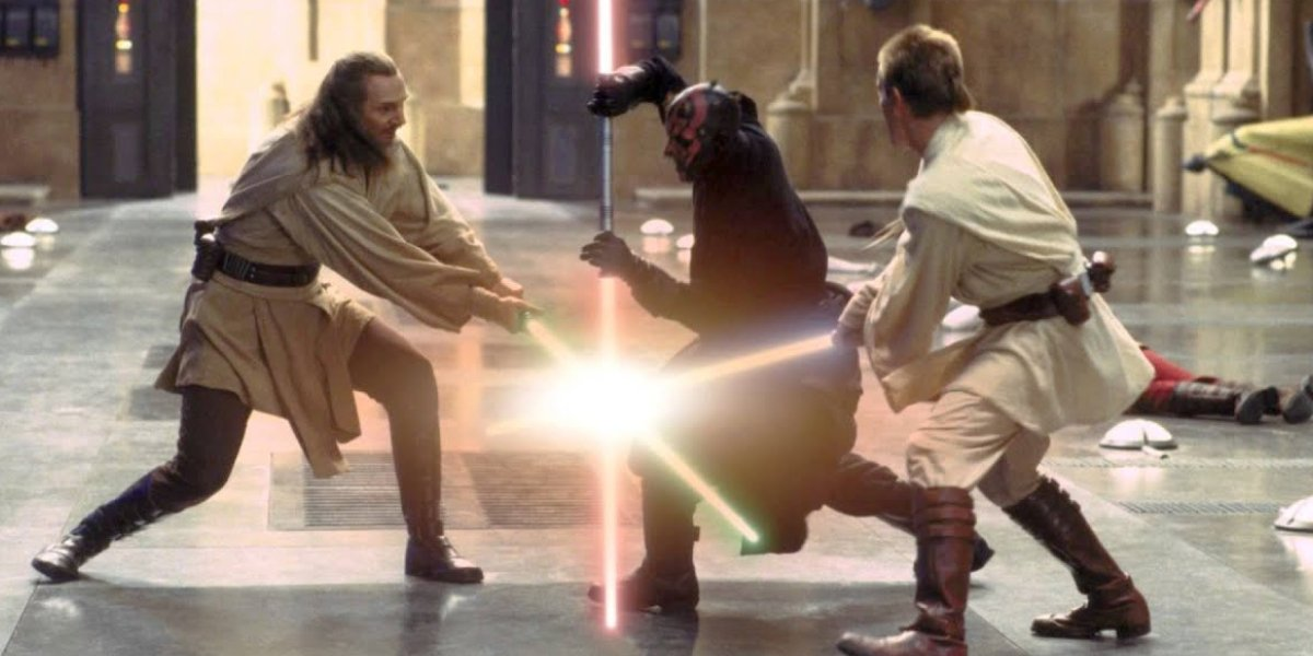 Qui-Gon Jinn and Obi-Wan Kenobi in a lightsaber duel with Darth Maul