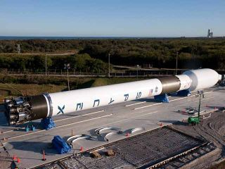 Complete integration of SpaceX's first Falcon 9 rocket at Cape Canaveral.