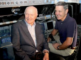 John Glenn and Bob Cabana on the flight deck of the space shuttle Discovery.