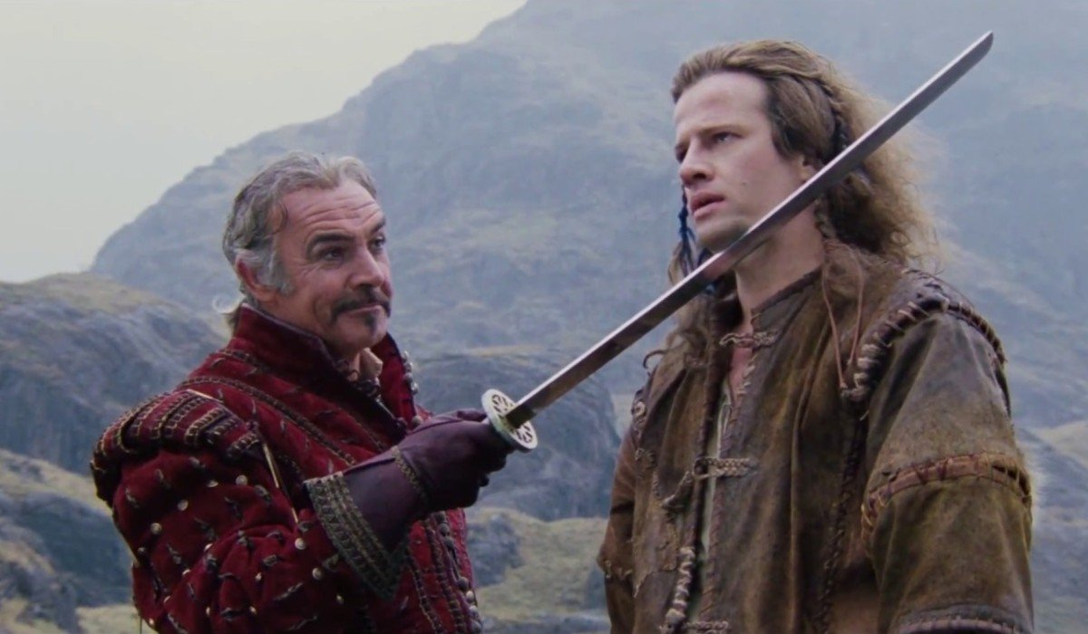 Highlander Sean Connery holds Christopher Lambert by blade