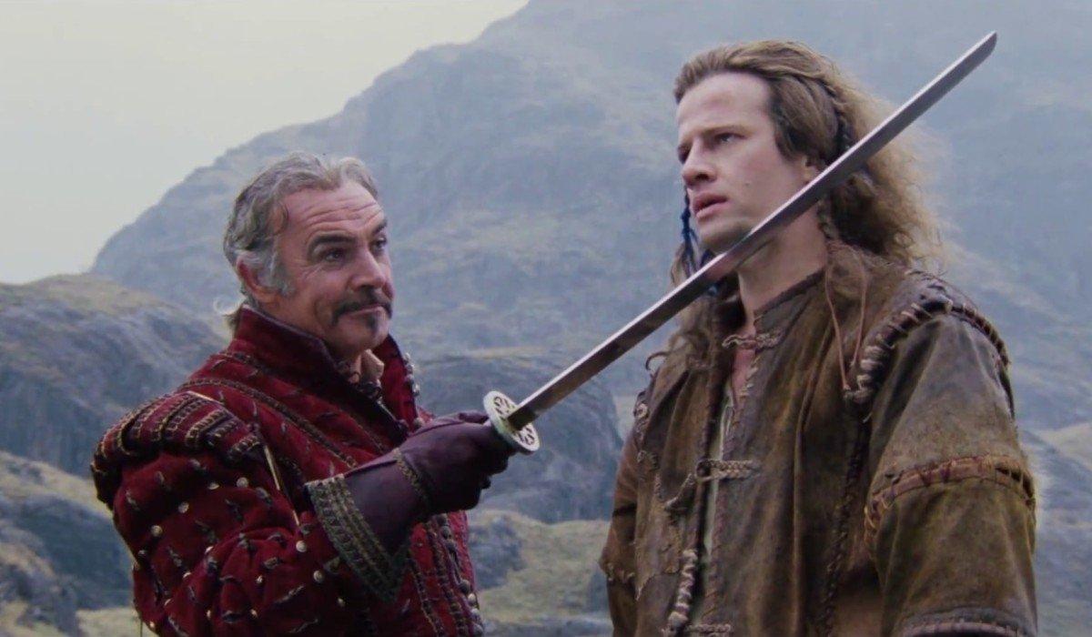 Highlander Sean Connery holds Christopher Lambert by blade