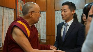 A picture showing Freddy Lim's meeting with the Dalai Lama