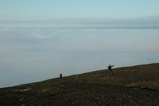 Terry Plank doing field research on the Seguam volcano in Alaska.