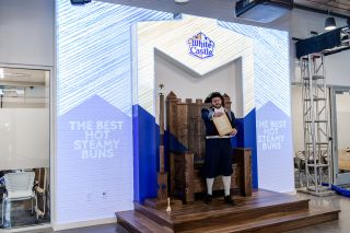 White Castle's Town Crier character stopped by the recent unveiling party, introducing the company's Craver Throne with an official proclamation and a speech.