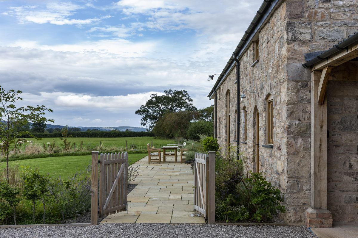This Welsh barn was rebuilt stone by stone and is now at one with its glorious country setting