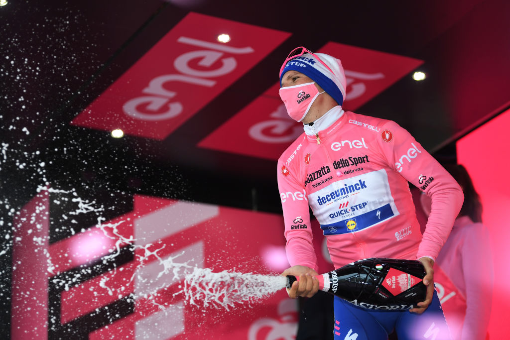 TORTORETO ITALY OCTOBER 13 Podium Joao Almeida of Portugal and Team Deceuninck QuickStep Pink Leader Jersey Celebration Champagne during the 103rd Giro dItalia 2020 Stage 10 a 177km stage from Lanciano to Tortoreto girodiitalia Giro on October 13 2020 in Tortoreto Italy Photo by Tim de WaeleGetty Images