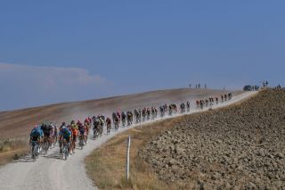 SIENA ITALY AUGUST 01 Hugo Houle of Canada and Astana Pro Team Jakob Fuglsang of Denmark and Astana Pro Team Manuele Boaro of Italy and Astana Pro Team Peloton Dust Gravel Strokes Landscape during the Eroica 14th Strade Bianche 2020 Men a 184km race from Siena to SienaPiazza del Campo StradeBianche on August 01 2020 in Siena Italy Photo by Tim de WaeleGetty Images