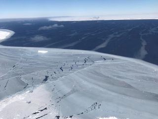 Looking out from the sea ice to iceberg A68, around November 2017, just months after the berg calved from Antarctica's Larsen C Ice Shelf in July.