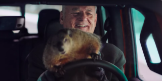 Bill Murray drives with a groundhog in his lap in Jeep's 2020 Super Bowl ad.