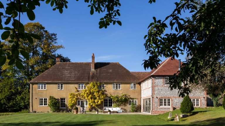 Exterior of 1920s country house with new wing in Wiltshire