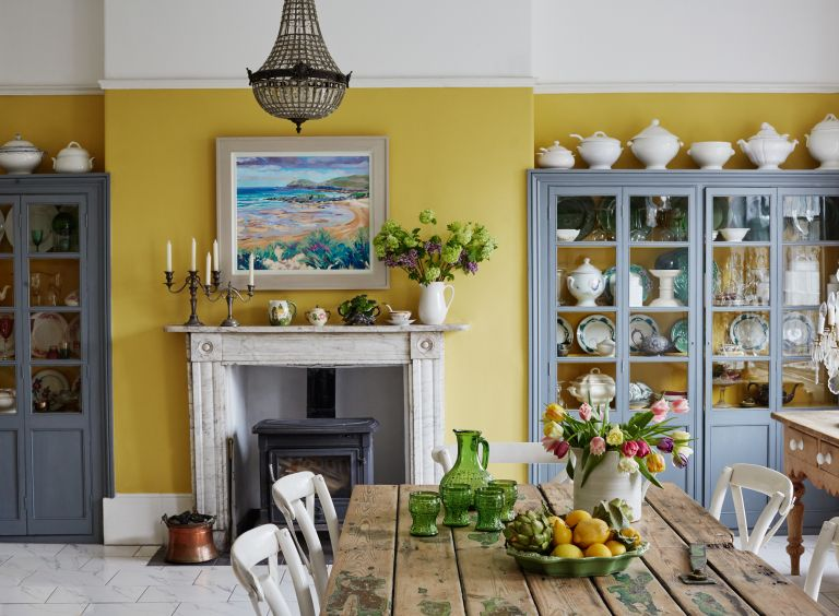 Yellow room ideas: kitchen with yellow walls and china in Georgian townhouse