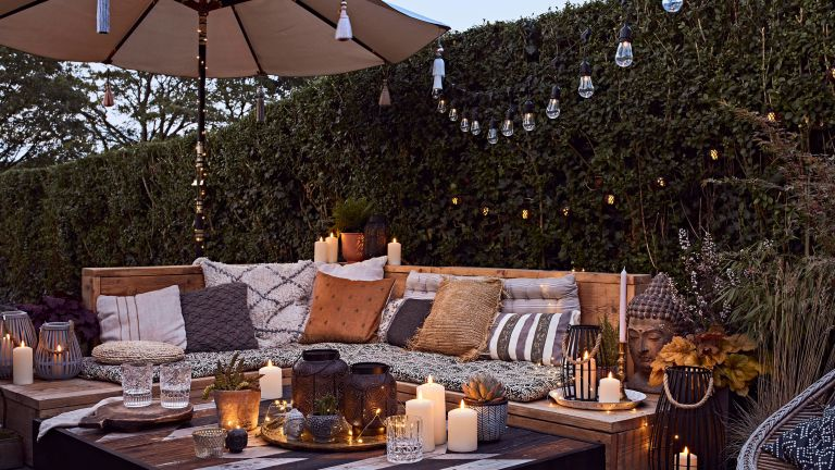 roost episode 3---outdoor-seating-in-garden-with-lighting-and-candles---Pic-credit-Lights4Fun