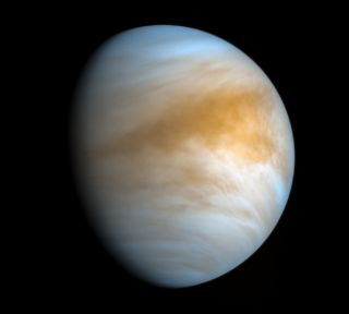 The bizarre and hellish atmosphere of Venus wafts around the planet's surface in this false-color image from the Japanese Aerospace Exploration Agency's Akatsuki spacecraft. Citizen scientist Kevin Gill processed the image using infrared and ultraviolet views captured by Akatsuki on Nov. 20, 2016.