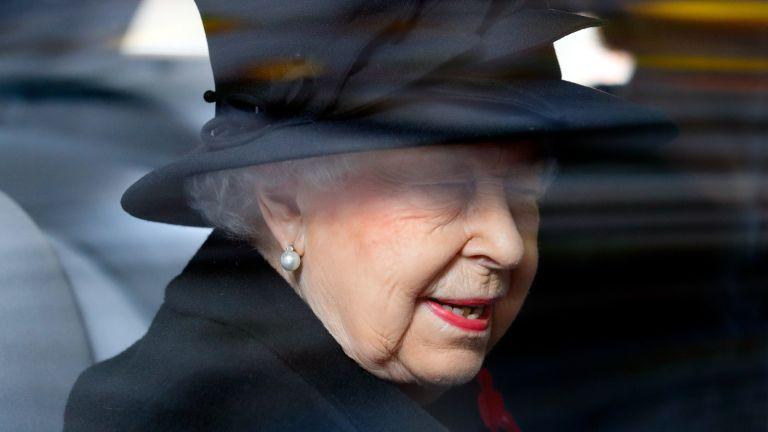 Queen's heartbreak: Queen Elizabeth II travels in her chauffeur driven Bentley car
