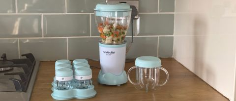Nutribullet Baby on a kitchen countertop filled with buttersquash and surrounded by its accessories