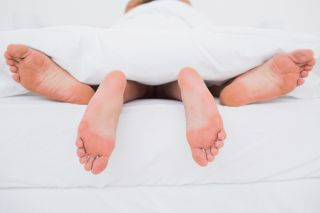 Couple in bed after heart attack, healthy sex after heart attack