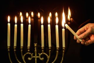 Lighting the menorah.
