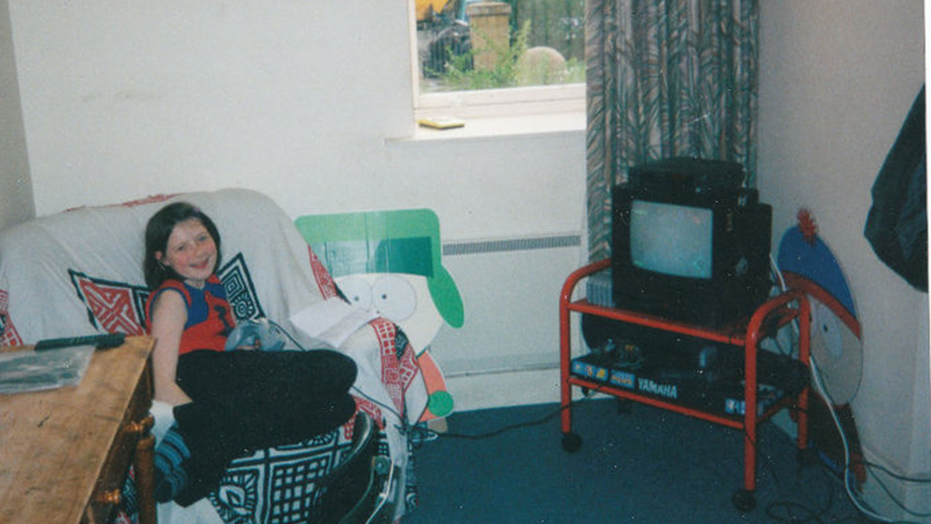 Rosalie playing Shenmue in the early Noughties.