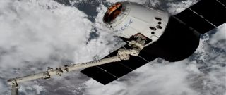 Astronauts aboard the ISS snagged the uncrewed Dragon today (April 4) at 6:40 a.m. EDT (1040 GMT) using the orbiting lab's huge Canadarm2 robotic arm.