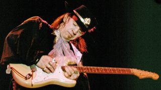 Stevie Ray Vaughan playing guitar