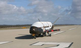 An image of the X-37B space plane prototype on a runway during flight tests by the United States Aur Force.