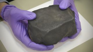 Don't let its humble appearance fool you; this so-called mudball meteorite holds important clues about how life began on Earth.