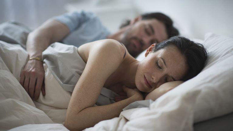 Sleep divorce: couple sleeping in bed