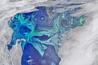 An image shows the pale-blue swirls of the Great Calcite Belt.