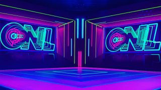 Gamescom Opening Night stage, brightly illuminated with ONL neon signs