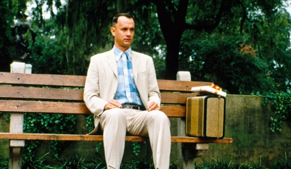 Forrest Gump Tom Hanks sits on his park bench, with his suitcase, waiting