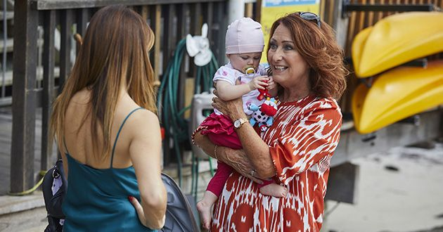 Irene Roberts and Leah Patterson-Baker play with baby Luc unaware Mick Jennings is watching in Home and Away.