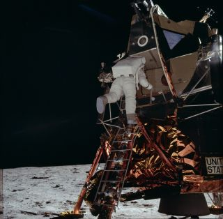 Buzz Aldrin, the second person to walk on the moon, descends the ladder to the lunar surface.