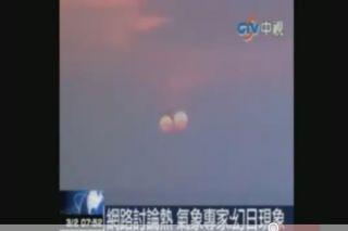 "A still from a video that purportedly shows a ""two suns"" setting in China. One scientists suspects the apparition could be an optical illusion at sunsets, rather than an all-out hoax."