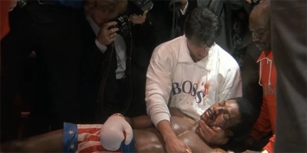 Rocky holding a lifeless Apollo Creed