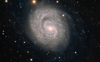 Spiral galaxy NGC 1637 space wallpaper by ESO's Very Large Telescope
