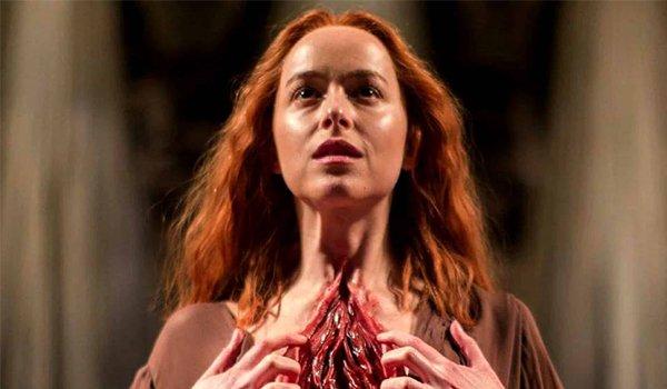 Suspiria Dakota Johnson opening her chest