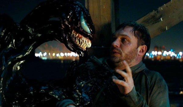 Venom stares down Eddie on the docks at night