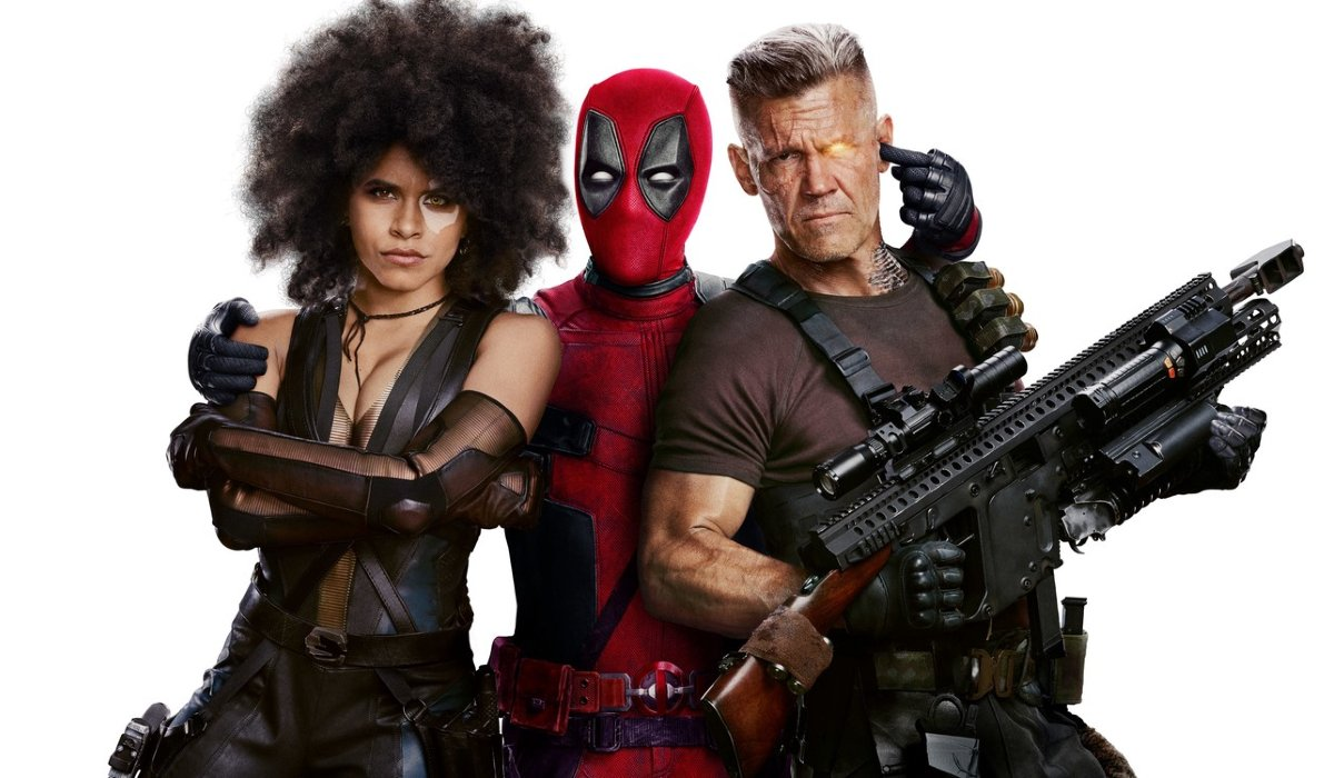 Deadpool 2 Domino, Deadpool, and Cable pose for the camera, as friends
