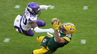 Equanimeous St. Brown #19 of the Green Bay Packers with a failed catch attempt as Jeff Gladney #20 of the Minnesota Vikings defends during the fourth quarter at Lambeau Field on Nov. 1, 2020 in Green Bay, Wisconsin.