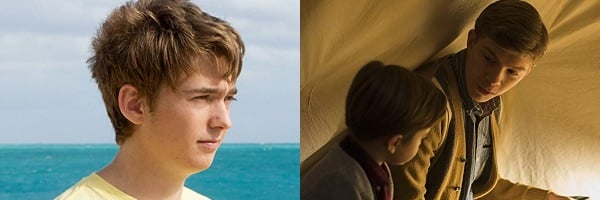 Austin Abrams standing on the beach in the sun Gabriel Rush sitting in a tent telling a story