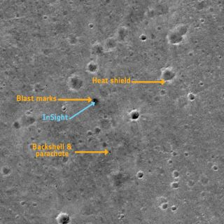 A photo captured by the European Space Agency's ExoMars orbiter shows NASA's InSight lander and the equipment that helped it to reach the surface safely.