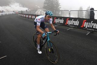 MONTE ZONCOLAN ITALY MAY 22 Aleksander Vlasov of Russia and Team Astana Premier Tech White Best Young Rider Jersey at Monte Zoncolan 1730m during the 104th Giro dItalia 2021 Stage 14 a 205km stage from Cittadella to Monte Zoncolan 1730m UCIworldtour girodiitalia Giro on May 22 2021 in Monte Zoncolan Italy Photo by Stuart FranklinGetty Images