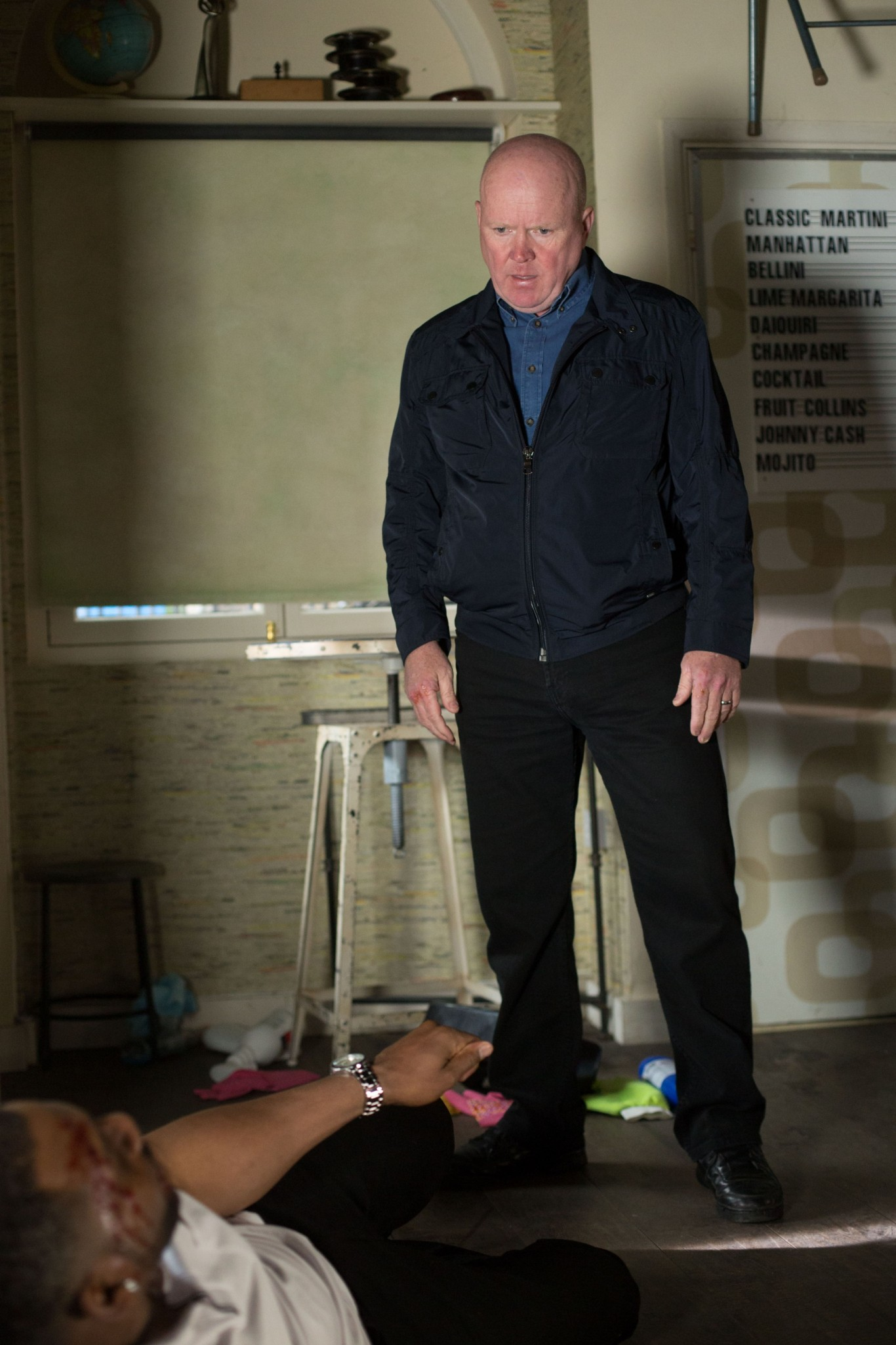 EastEnders Vincent, played by Richard Blackwood, is left a bloody pulp by Phil Mitchell, played by Steve McFadden