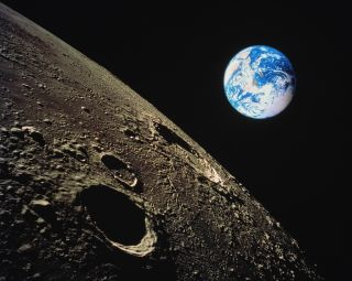 The surface of the moon with Earth in the background. (Composite image)