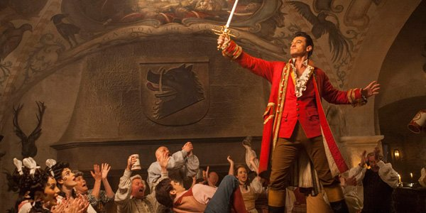 gaston raising sword in triumph in beauty and the beast