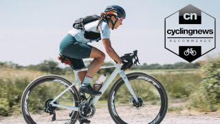 Woman riding a Cannondale gravel bike whilst wearing a Giro gravel bike helmet