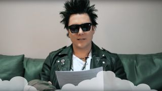 Avenged Sevenfold guitarist Synyster Gates reading tweets from a piece of paper