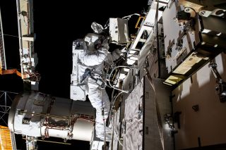 NASA astronaut Bob Behnken is pictured during a spacewalk to swap batteries and upgrade power systems on the International Space Station's Starboard-6 truss structure, on June 26, 2020. Behnken was joined during the six-hour and seven-minute excursion by NASA astronaut Chris Cassidy (out of frame).